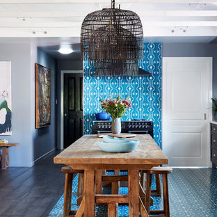Eclectic l-shaped eat-in kitchen in Other with recessed-panel cabinets, black cabinets, white splashback, black appliances, with island, blue floor and white benchtop.