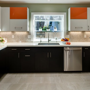 Design ideas for a mid-sized contemporary u-shaped eat-in kitchen in San Francisco with an undermount sink, flat-panel cabinets, orange cabinets, quartz benchtops, grey splashback, porcelain splashback, stainless steel appliances, porcelain floors and a peninsula.