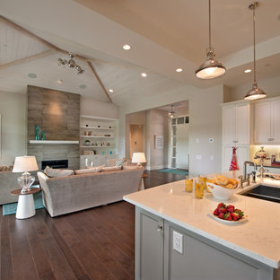 Example of a trendy open concept kitchen design in Vancouver with a double-bowl sink, recessed-panel cabinets, white cabinets and stainless steel appliances