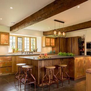 Large country l-shaped kitchen in Other with a double-bowl sink, an island, flat-panel cabinets, brown cabinets and grey floors.