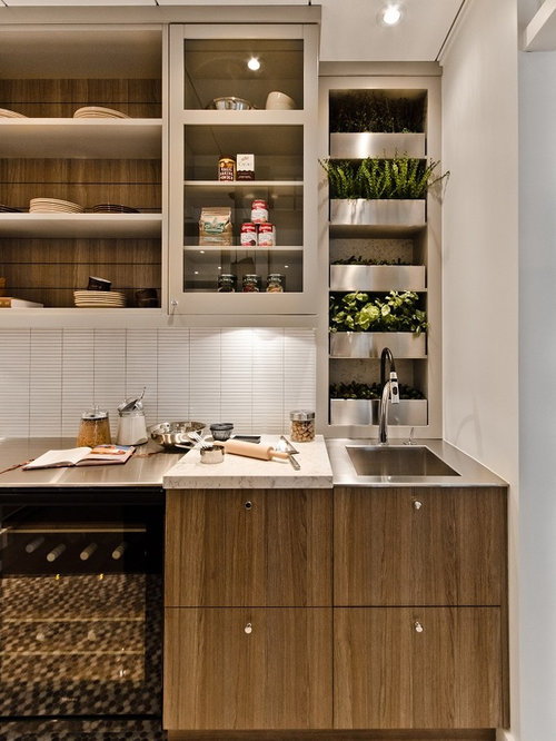 example of a trendy kitchen design in montreal with glass front cabinets matchstick tile - Matchstick Tile Garden Decoration