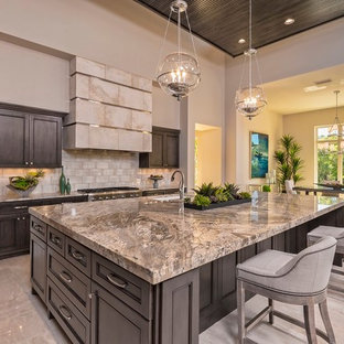 Inspiration for a large transitional open plan kitchen in Austin with an undermount sink, beaded inset cabinets, dark wood cabinets, beige splashback, stainless steel appliances, with island, granite benchtops, subway tile splashback, marble floors and beige floor.