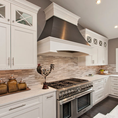 Example of a large transitional kitchen design in DC Metro with shaker cabinets, white cabinets, marble countertops, stone tile backsplash and white countertops