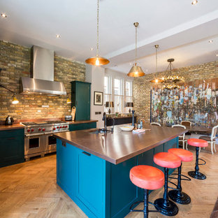 Eclectic kitchen remodeling - Example of an eclectic kitchen design in London