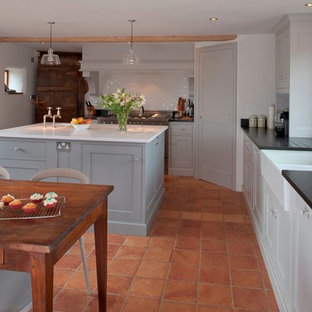 Design ideas for a rustic kitchen in Kent with recessed-panel cabinets, a belfast sink and grey cabinets.
