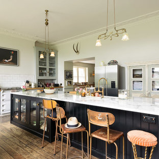 Large eclectic enclosed kitchen ideas - Large eclectic single-wall medium tone wood floor and brown floor enclosed kitchen photo in Other with shaker cabinets, gray cabinets, marble countertops, white backsplash, subway tile backsplash, white appliances and a peninsula