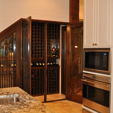 Traditional Wine Cellar by The Front Door / Dwayne Carruth