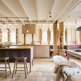Design ideas for a large rustic single-wall open plan kitchen in Other with flat-panel cabinets, light wood cabinets, wood worktops and an island.