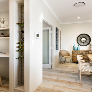 Photo of a large beach style u-shaped kitchen pantry in Perth with an undermount sink, flat-panel cabinets, light wood cabinets, quartz benchtops, multi-coloured splashback, ceramic splashback, stainless steel appliances, ceramic floors and no island.