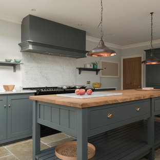 Contemporary eat-in kitchen remodeling - Eat-in kitchen - contemporary limestone floor eat-in kitchen idea in Other with shaker cabinets, gray cabinets and an island