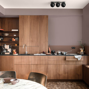 Contemporary eat-in kitchen ideas - Eat-in kitchen - contemporary l-shaped eat-in kitchen idea in Berkshire with an integrated sink, flat-panel cabinets, dark wood cabinets and paneled appliances