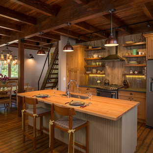 Mid-sized country eat-in kitchen in Albuquerque with ceramic splashback, dark hardwood floors, with island, an undermount sink, shaker cabinets, medium wood cabinets, wood benchtops and grey splashback.