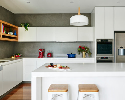 this is an example of a modern l shaped open plan kitchen in melbourne with - Modern Kitchen