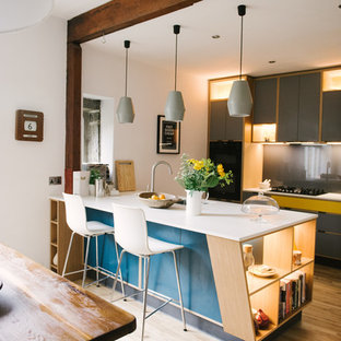 Design ideas for a medium sized contemporary kitchen in Other with flat-panel cabinets, grey splashback, light hardwood flooring, an island, beige floors and white worktops.