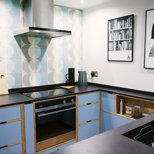 Photo of a small midcentury u-shaped kitchen in Other with flat-panel cabinets, blue cabinets, no island, black worktops, an integrated sink, blue splashback and black appliances.