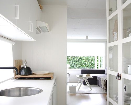 Scandinavian galley enclosed kitchen idea in Amsterdam with a drop-in sink,  flat-