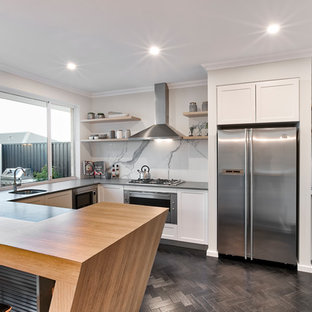 Design ideas for a mid-sized contemporary u-shaped separate kitchen in Perth with a single-bowl sink, white cabinets, white splashback, stainless steel appliances, shaker cabinets, stone slab splashback, dark hardwood floors, no island, brown floor and black benchtop.