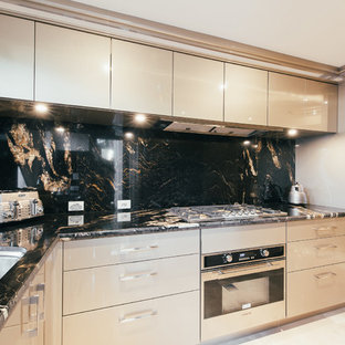 This is an example of a large transitional u-shaped separate kitchen in Perth with a double-bowl sink, beige cabinets, granite benchtops, black splashback, stone slab splashback, stainless steel appliances, marble floors and no island.