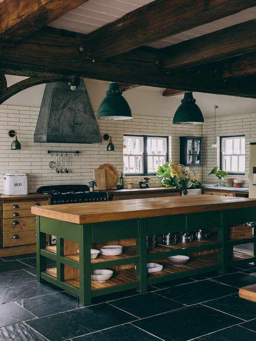 Country L Shaped Kitchen In London With A Belfast Sink, Open Cabinets, Green