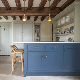 Inspiration for a country kitchen in West Midlands with shaker cabinets, blue cabinets, beige floor and white benchtop.