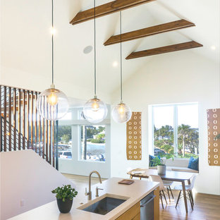 Design ideas for a mid-sized contemporary l-shaped eat-in kitchen in Los Angeles with an undermount sink, flat-panel cabinets, medium wood cabinets, concrete benchtops, stainless steel appliances, bamboo floors, with island and brown floor.