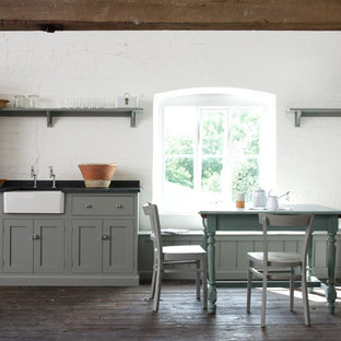 Farmhouse eat-in kitchen ideas - Country dark wood floor eat-in kitchen photo in Other