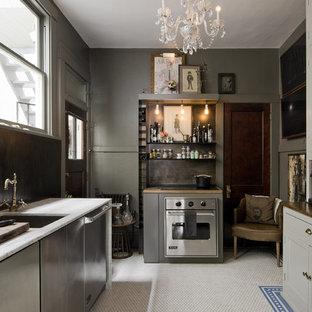 Kleine Eklektische Küche ohne Insel mit Unterbauwaschbecken, Glasfronten, grauen Schränken, Küchengeräten aus Edelstahl, Marmor-Arbeitsplatte, Küchenrückwand in Braun und Keramikboden in Salt Lake City