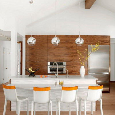 Inspiration for a scandinavian galley light wood floor kitchen remodel in St Louis with an undermount sink, flat-panel cabinets, medium tone wood cabinets, stainless steel appliances, an island and quartz countertops