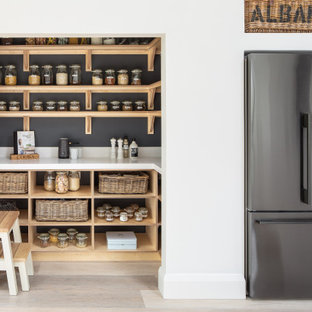 Inspiration for a rural open plan kitchen in Kent with shaker cabinets, white cabinets and an island.