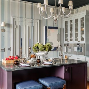 Design ideas for a small traditional enclosed kitchen in Boston with a submerged sink, purple cabinets, soapstone worktops, stainless steel appliances, medium hardwood flooring, an island, brown floors and shaker cabinets.