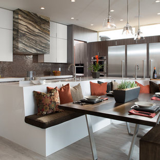 Photo of a contemporary l-shaped eat-in kitchen in Sacramento with flat-panel cabinets, grey cabinets, metallic splashback, mosaic tile splashback, stainless steel appliances and with island.