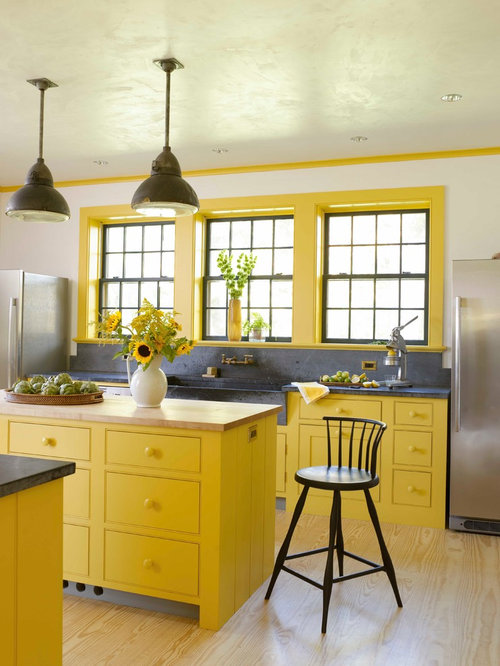 Example of a country light wood floor kitchen design in New York with a  farmhouse sink