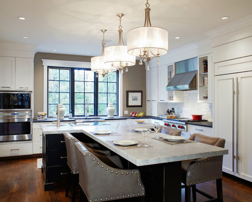 Example of a large classic l-shaped dark wood floor enclosed kitchen design  in Philadelphia