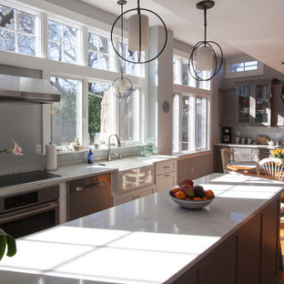 Large contemporary eat-in kitchen designs - Example of a large trendy u-shaped eat-in kitchen design in Boston with an undermount sink, shaker cabinets, white cabinets, quartz countertops, stainless steel appliances and an island