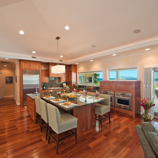 Contemporary open concept kitchen remodeling - Example of a trendy l-shaped open concept kitchen design in Hawaii with stainless steel appliances, green backsplash and stone slab backsplash