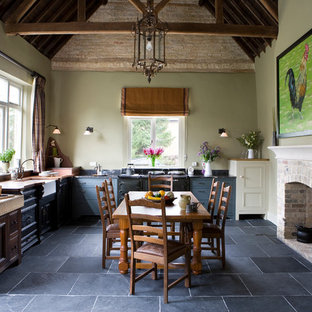 Large country l-shaped slate floor eat-in kitchen photo in Other with a farmhouse sink, recessed-panel cabinets, gray cabinets, no island and black appliances