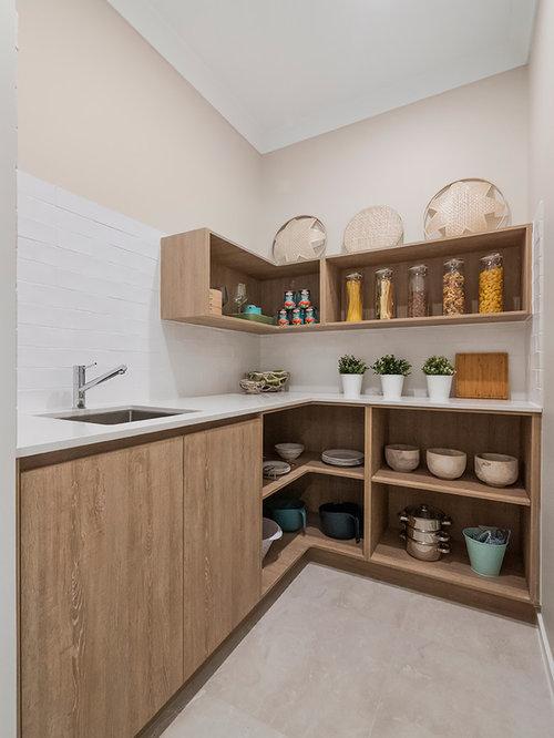 contemporary kitchen furniture. Inspiration For A Contemporary Kitchen Pantry In Brisbane With Ceramic Splashback, Floors, Beige Furniture