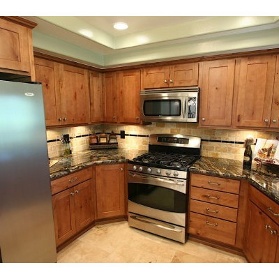 Example of a small transitional u-shaped travertine floor eat-in kitchen design in Other with an undermount sink, shaker cabinets, medium tone wood cabinets, granite countertops, beige backsplash, stone tile backsplash, stainless steel appliances and no island