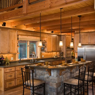Large rustic open concept kitchen photos - Inspiration for a large rustic galley dark wood floor open concept kitchen remodel in Charlotte with an undermount sink, medium tone wood cabinets, quartzite countertops, stainless steel appliances, an island and shaker cabinets