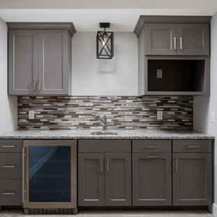 Design ideas for a small arts and crafts single-wall kitchen pantry in Grand Rapids with an undermount sink, recessed-panel cabinets, grey cabinets, quartz benchtops, multi-coloured splashback, ceramic splashback, stainless steel appliances, carpet, no island, grey floor and multi-coloured benchtop.
