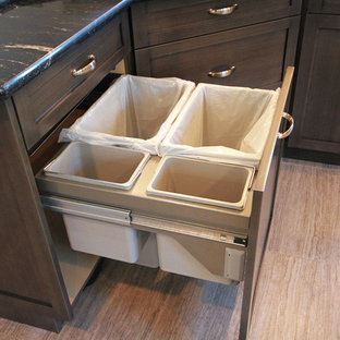 Inspiration for a rustic kitchen pantry in Calgary with a submerged sink, distressed cabinets, white splashback, stainless steel appliances, light hardwood flooring and an island.