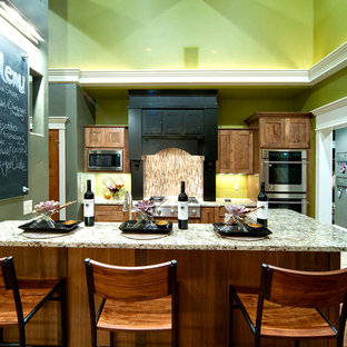 Small farmhouse eat-in kitchen designs - Inspiration for a small cottage galley medium tone wood floor eat-in kitchen remodel in Other with an undermount sink, shaker cabinets, medium tone wood cabinets, granite countertops, beige backsplash, glass tile backsplash, stainless steel appliances and an island