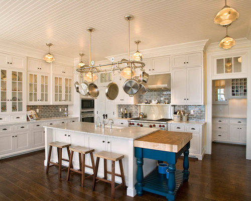 Inspiration For A Large Timeless U Shaped Medium Tone Wood Floor And Brown  Floor Kitchen