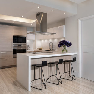 Contemporary kitchen designs - Inspiration for a contemporary u-shaped ceramic tile and beige floor kitchen remodel in Miami with flat-panel cabinets, light wood cabinets, quartzite countertops, ceramic backsplash, stainless steel appliances, white countertops, an undermount sink, white backsplash and a peninsula