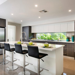 Photo of a mid-sized contemporary galley eat-in kitchen in Perth with an undermount sink, dark wood cabinets, quartz benchtops, brown splashback, glass sheet splashback, stainless steel appliances, porcelain floors and an island.