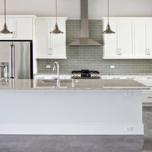 Mid-sized modern eat-in kitchen designs - Inspiration for a mid-sized modern l-shaped concrete floor eat-in kitchen remodel in Jacksonville with an undermount sink, shaker cabinets, white cabinets, granite countertops, gray backsplash, subway tile backsplash, stainless steel appliances and an island