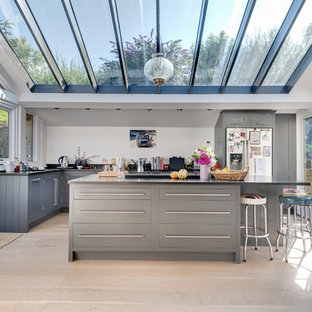 Design ideas for a contemporary l-shaped kitchen in Devon with flat-panel cabinets, grey cabinets and stainless steel appliances.