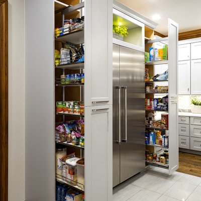 Large transitional medium tone wood floor and brown floor kitchen pantry photo in Oklahoma City with shaker cabinets, gray cabinets, stainless steel appliances and an island