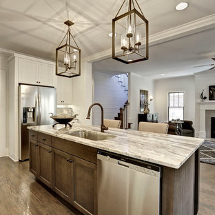 Transitional open concept kitchen designs - Open concept kitchen - transitional galley medium tone wood floor open concept kitchen idea in Atlanta with an undermount sink, shaker cabinets, white cabinets, quartzite countertops, white backsplash, stainless steel appliances and an island