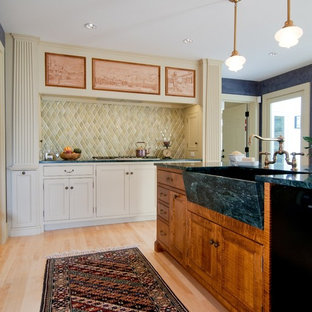 Inspiration for a traditional kitchen in Manchester with an integrated sink, recessed-panel cabinets, white cabinets and green splashback.